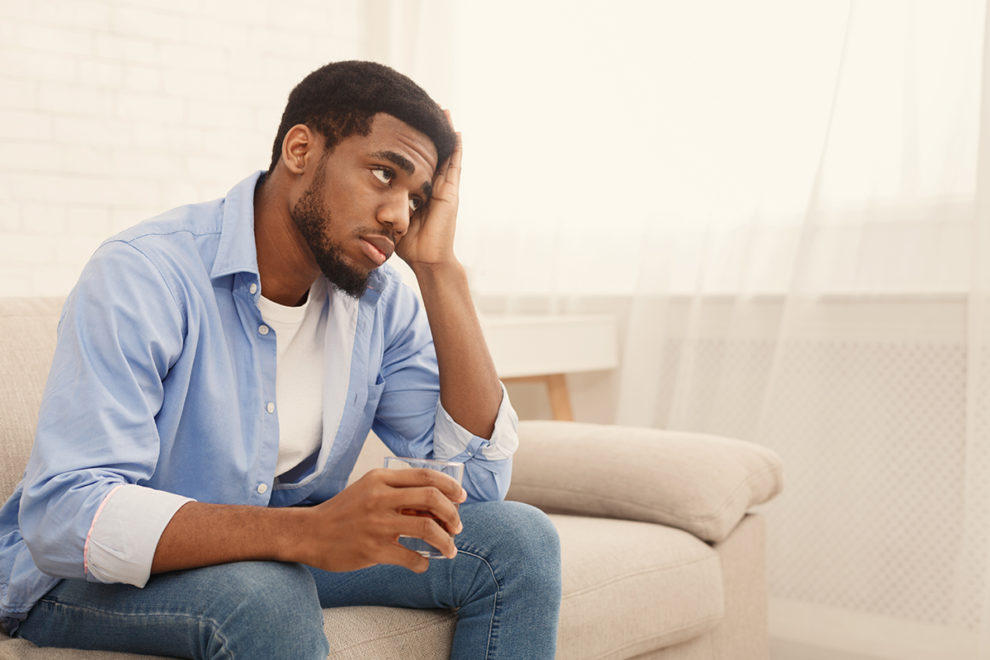 man struggling with alcohol detox at home