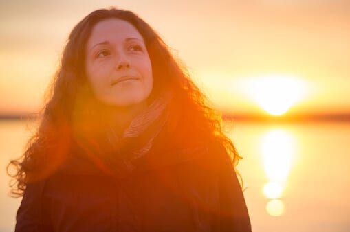 Young woman at sunset may have addictive personality traits.