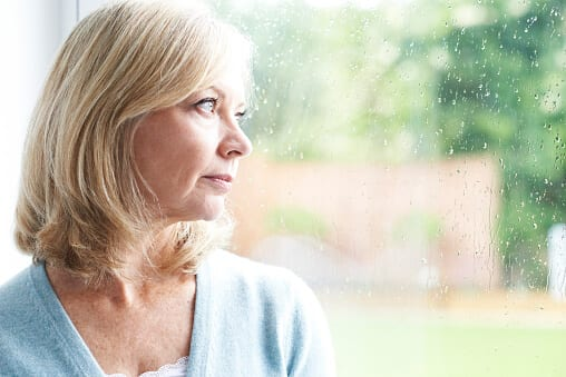 Amerihealth Rehab Insurance can help this sad woman pay for addiction treatment.