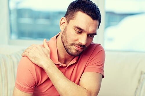 Man rubbing shoulder knows he needs a relapse prevention plan after rehab