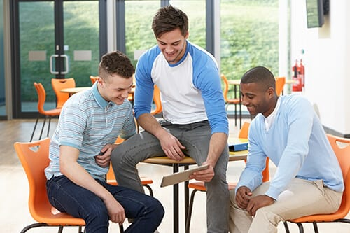 Men engaging in substance abuse group therapy activities