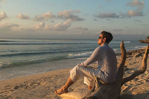 Man looking out over ocean during his benzo detox recovery at Tides Edge