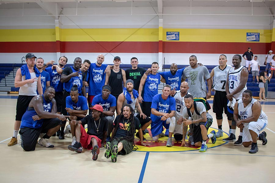 post-game picture at Beaches Recovery Alumni Program basketball game