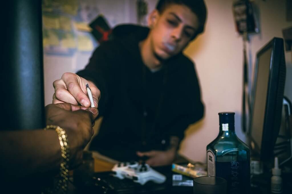 Young man struggling with adolescent drug abuse