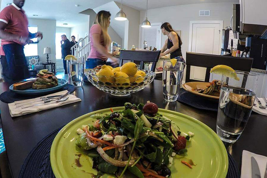 Patients in a drug rehab home working together to make dinner