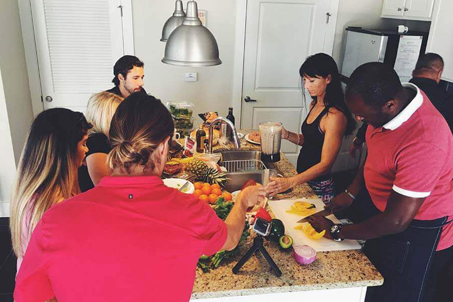 Patients in a drug rehab house working together to prepare dinner