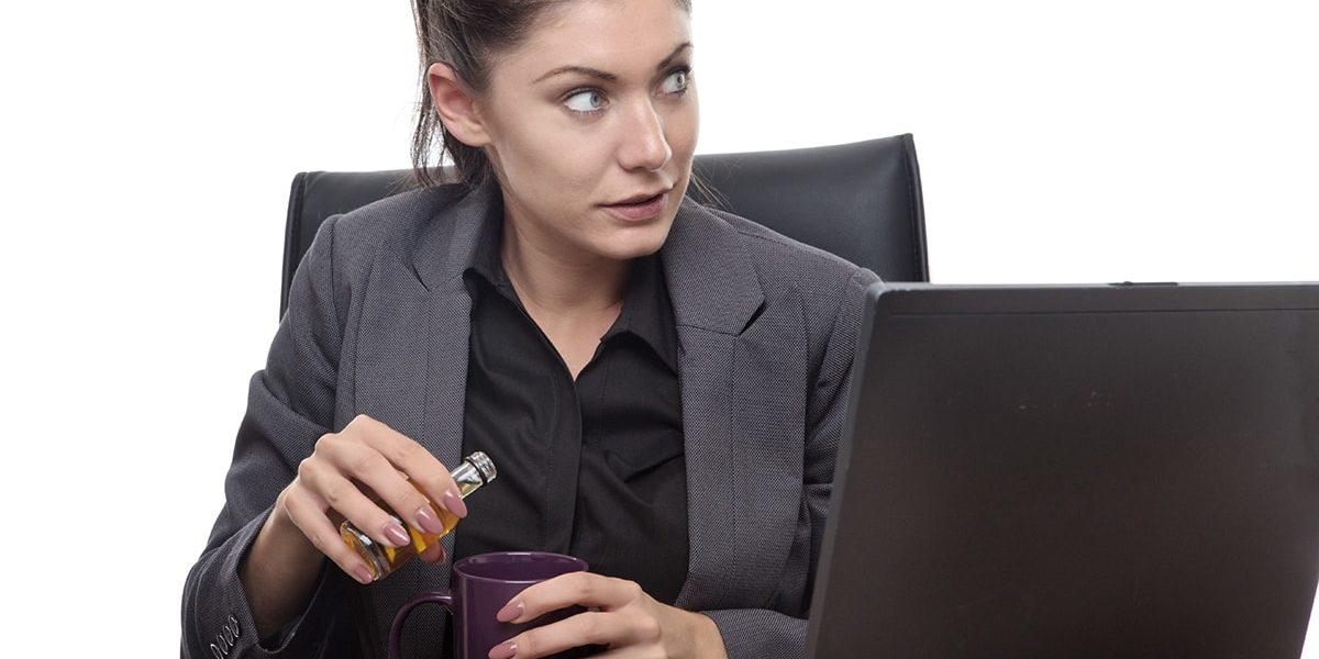 Woman who has an issue with drinking on the job
