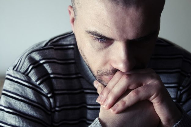 Man wondering how to stop alcohol withdrawal shakes