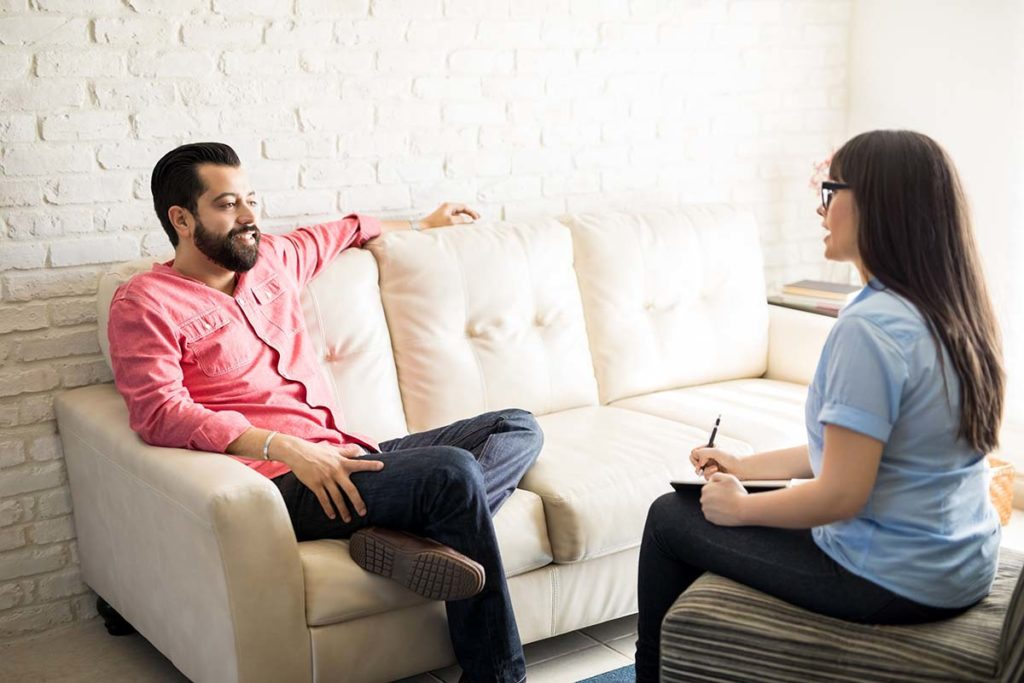 a man talks to his therapist about alternatives to a drug rehab center in atlanta ga
